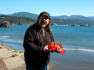 Aaron Longton is one of three fishermen in Port Orford who teamed up to form a community supported fishery based on sustainable fishing practices and direct marketing to conscientious seafood consumers. Here's he's holding one of his many seafood offerings: A vermillion rockfish. (Photo Courtesy Port Orford Sustainable Seafoods)
