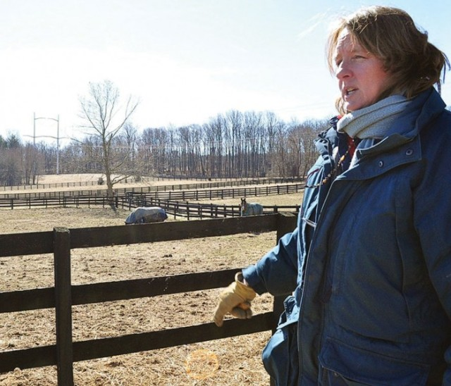 Pam Saul of Brookville, MD, points out the grassy sections between her horses' paddocks that she said buffers some of the nutrients before they reach the nearby stream. (Photo by Whitney Pipkin)