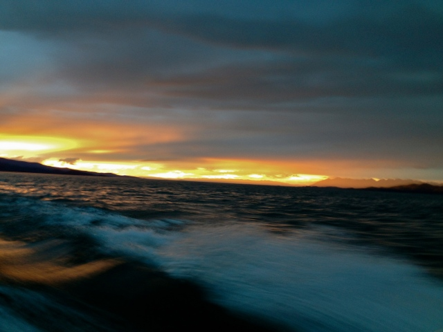 Sunset and wake on Flathead Lake.