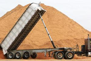 A truck dumps a load of sand at the loading terminal for Modern Transport Rail in Winona, Minn. (Phot by Andrew Link/Winona Daily News/AP/File)
