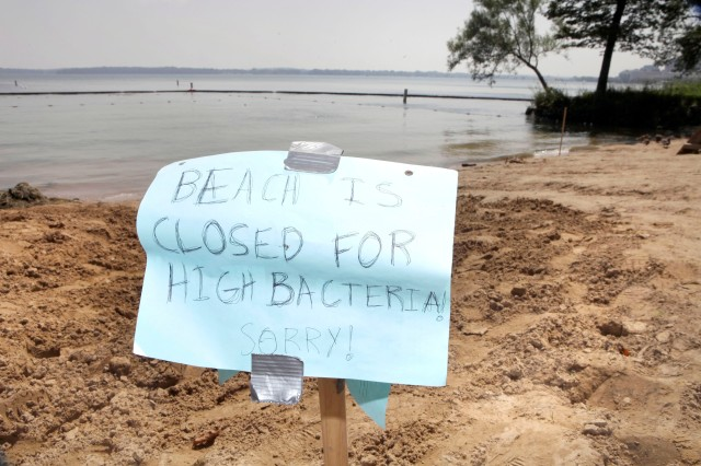 A experimental boom surrounded Madison's B.B. Clarke beach in 2010 to keep out algae, though it ended up being closed June 24 for high E. coli levels. Algae and bacteria are the prime causes for beach closures throughout the Madison area and the state. Mike DeVries/The Capital Times
